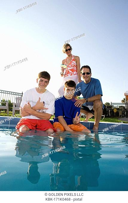 Family at the edge of a swimming pool