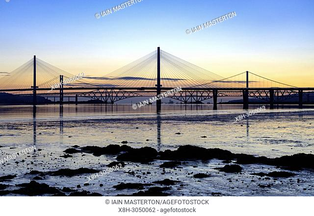Sunrise view of the three major bridges crossing the Firth of Forth at South Queensferry; Queensferry Crossing, North Road Bridge and the Forth Bridge ( rail)