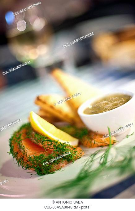 Plate of fish with lemon and herbs