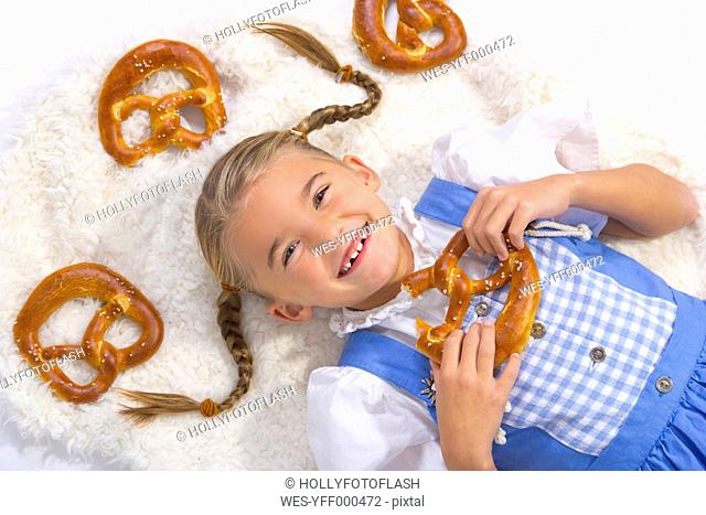 Portrait of happy little girl with pretzels