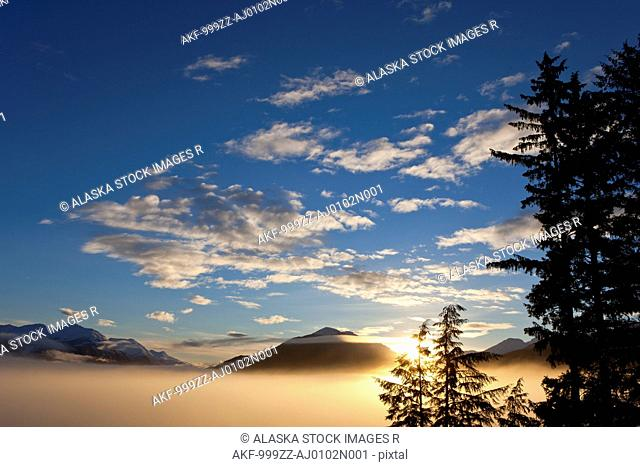 Fog blankets the lowlands at sunrise on Douglas Island near Juneau, Tongass National Forest, Inside Passage, Southeast Alaska, Winter