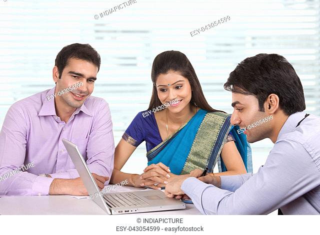 Couple sitting with financial advisor