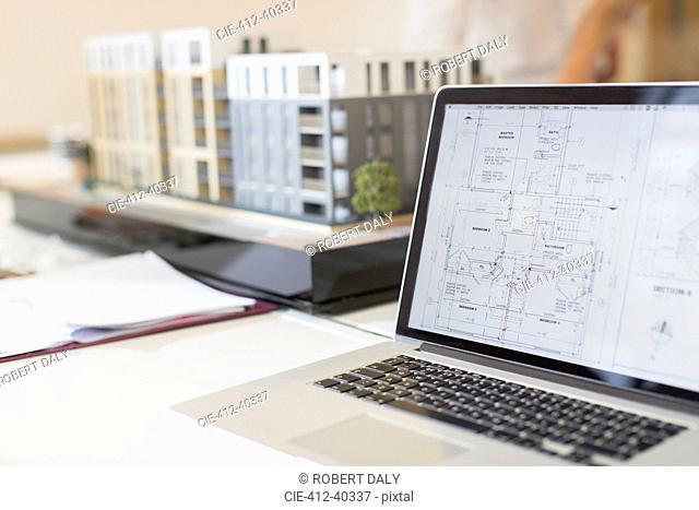 Digital blueprint on laptop next to model