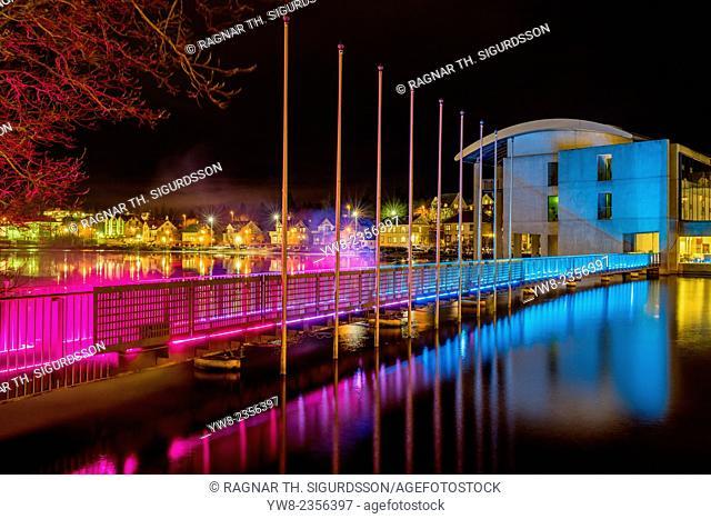 Colorful lights over the bridge, pond and City Hall, Winter lights festival, Reykjavik, Iceland