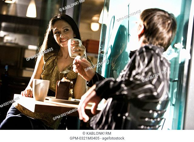 Young couple having dessert at a restaurant