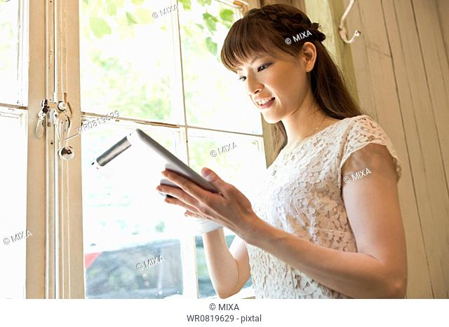 Young Woman Looking at Tablet PC