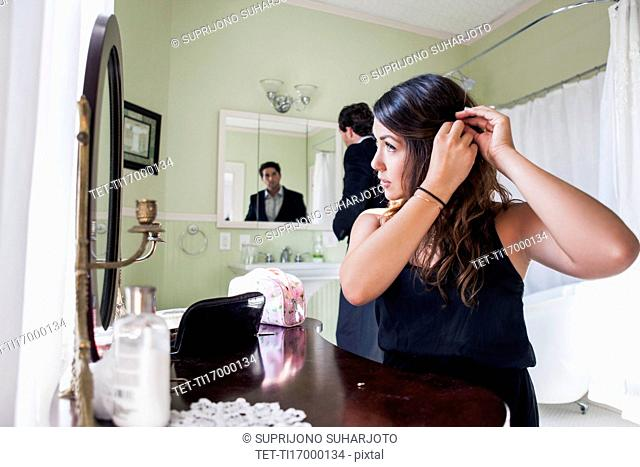 Young couple getting ready for party
