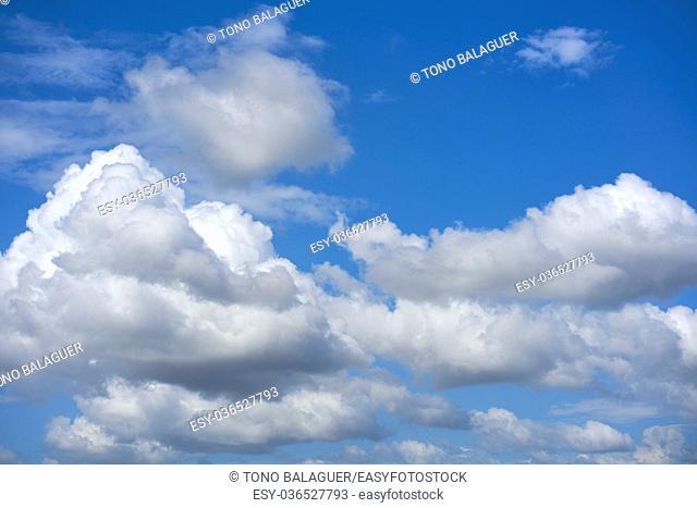 Blue summer sky white cumulus clouds background