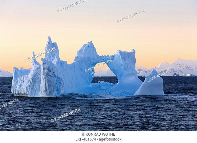 iceberg at sunrise on southern polar circle, Antarctica