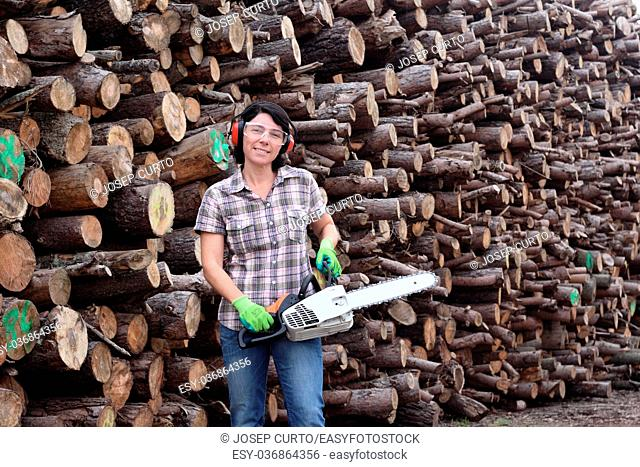 portrait of a woman with a chainsaw