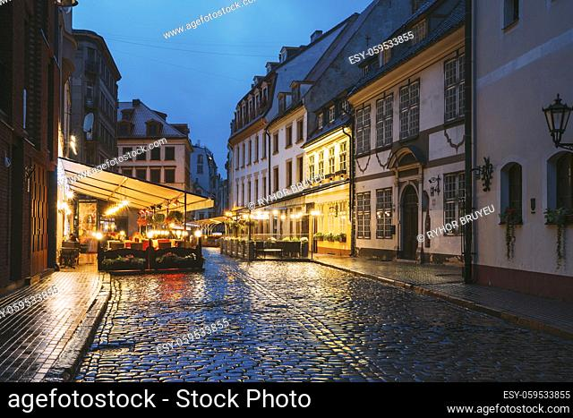 Riga, Latvia. Museum Of Decorative Arts And Design And Cafe In Lighting At Evening Or Night Illumination In Old Town In Skarnu Street