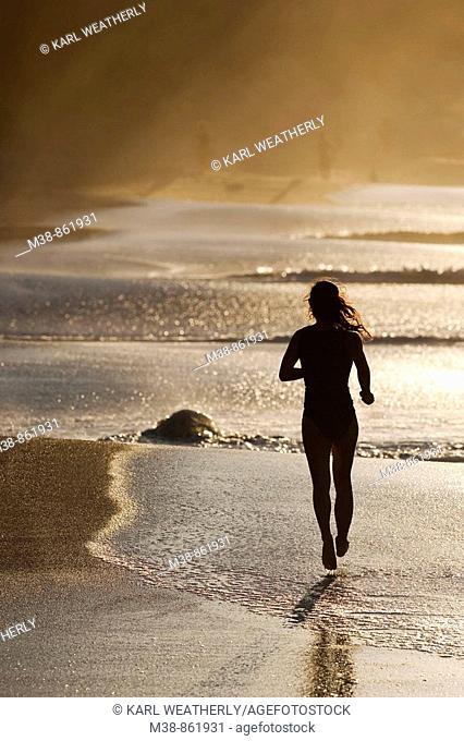 Woman running on the beach  Maui, Hawaii
