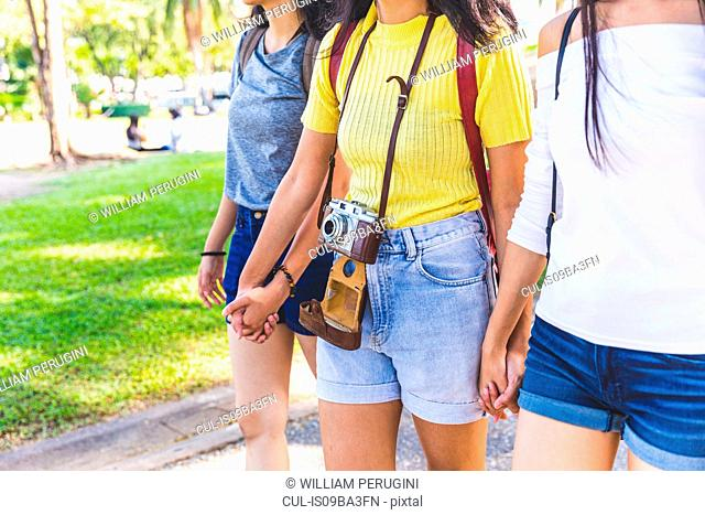 Friends walking and sightseeing in park, Bangkok, Thailand
