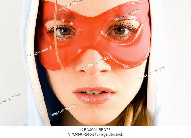 Portrait of a young woman wearing an eye mask