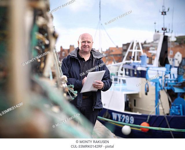 Fish inspector on fishing boat