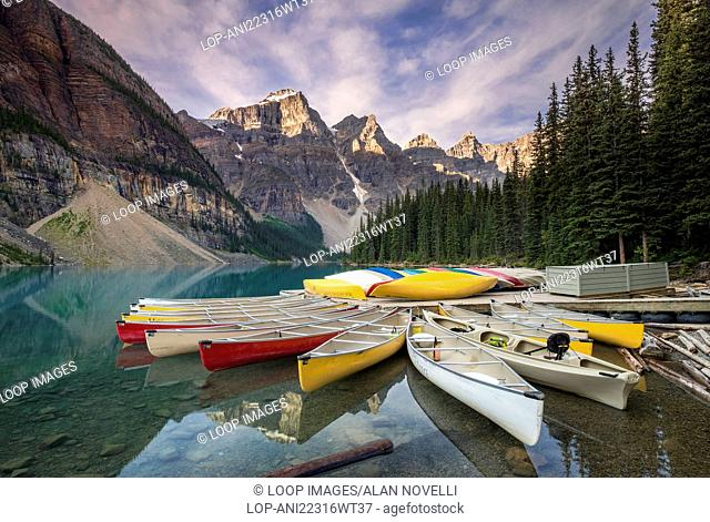 Multicoloured canoes on Moraine Lake in the valley of the ten peaks