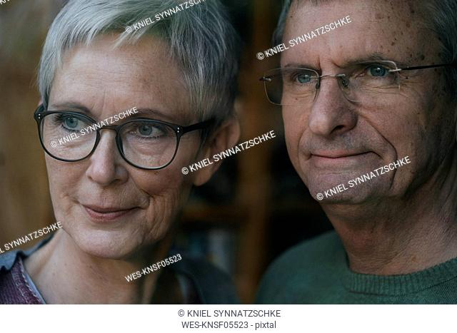 Confident senior couple looking out of window