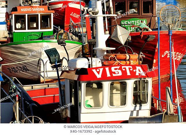 Fishing boats tied to the docks in Porto do Son, Coruña, Galicia, Spain