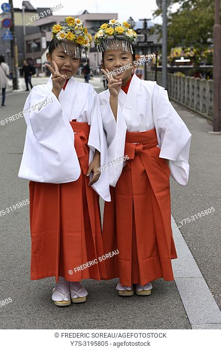 Young local dancer in traditional clothing during annual Takayama festival, one of the most famous festivals in Japan, Asia