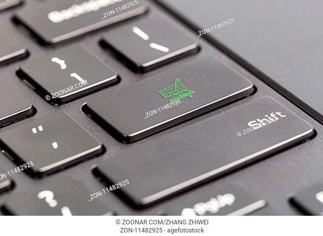 shopping cart key closeup on computer keyboard, online shopping concept