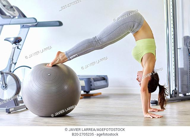 Woman training with fitness ball