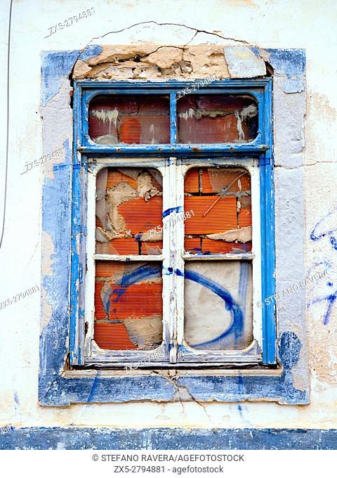 Damaged window in Faro - Algarve region, Portugal