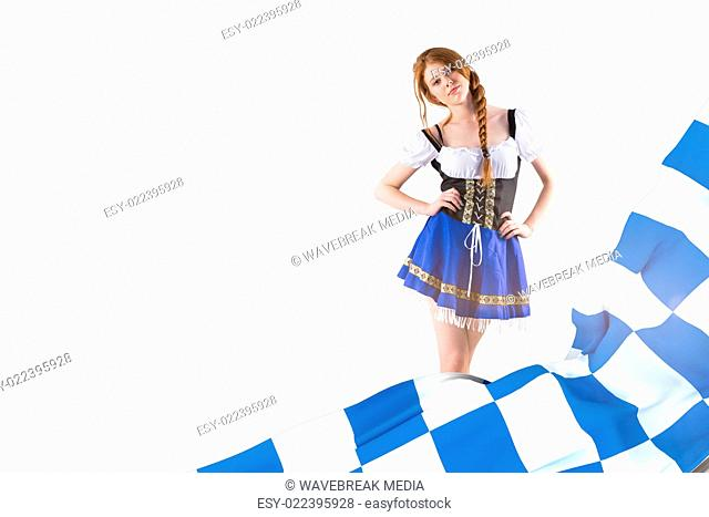 Composite image of oktoberfest girl looking at camera