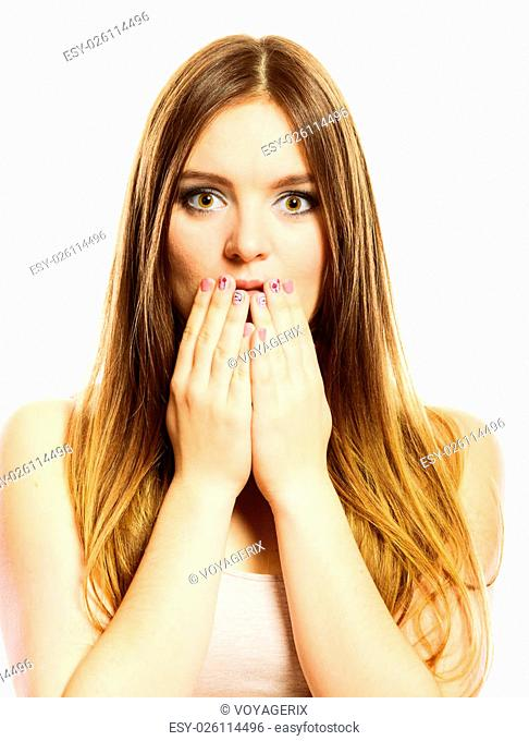 Speak no evil concept. Surprised woman face wide eyed covering her mouth with hands colorful nails design