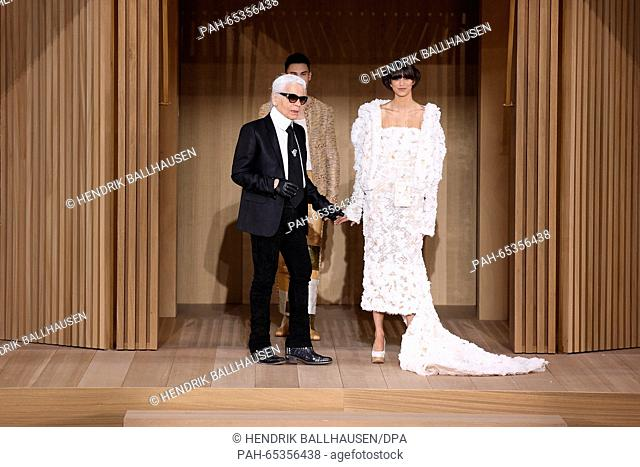 German designer Karl Lagerfeld (L) presents the Chanel spring/summer 2016 collection during the Paris Haute Couture fashion week, in Paris, France