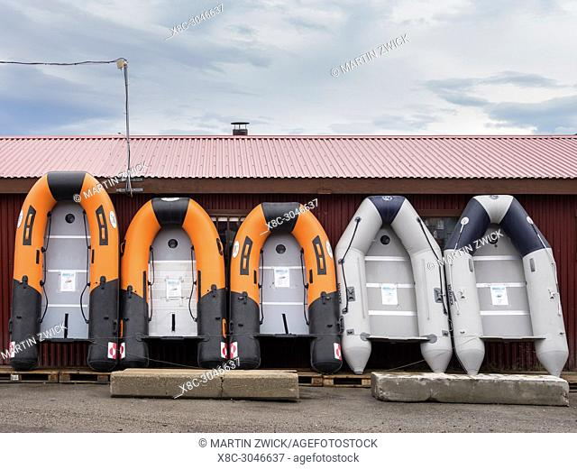 Rubber boat for sale. The harbour in town Ilulissat at the shore of Disko Bay in West Greenland, center for tourism, administration and economy