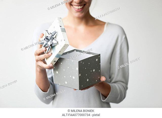 Woman opening gift box, cropped