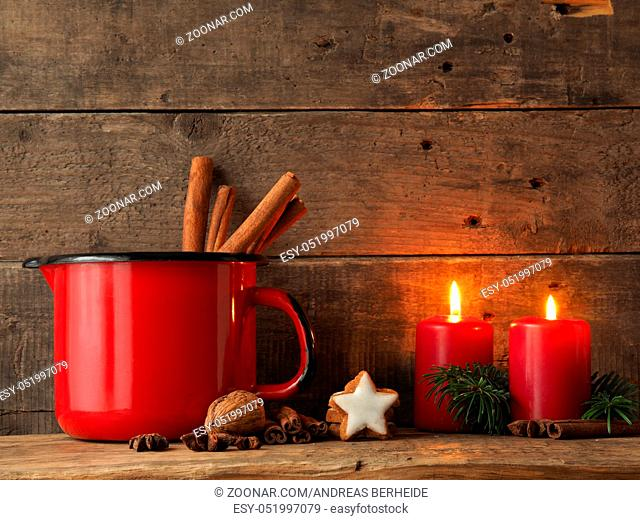 Chrsitmas background with bakes cinnamon star cookies on a wooden board