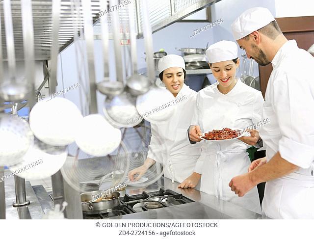 People preparing food in restaurant kitchen