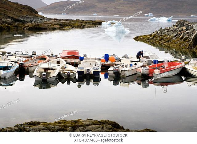 Fisherman working by his boat, Narsaq harbour, South Greenland