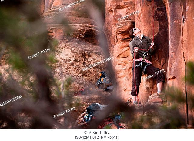 Spotter holding rock climbers rope