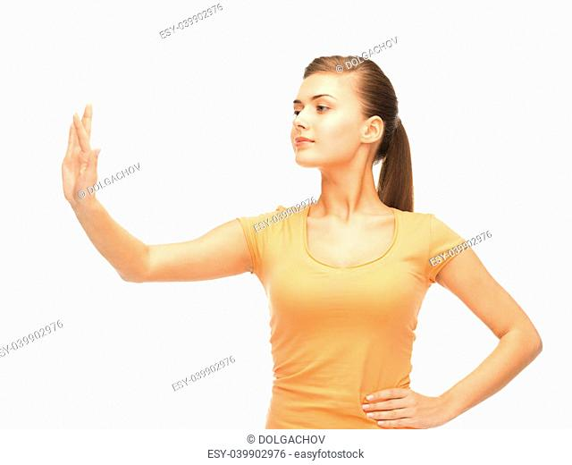 attractive girl in blank color t-shirt working with something imaginary