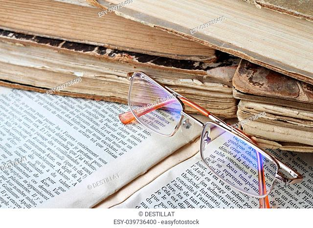 Glasses lying on open book