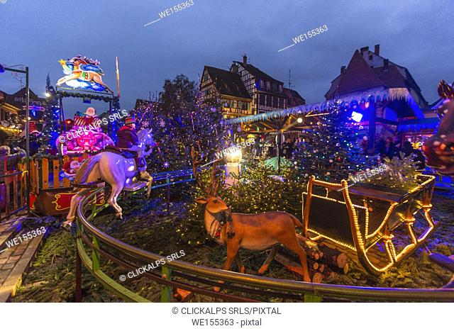 Christmas lights and typical carousel in the old medieval town Colmar Haut-Rhin department Alsace France Europe