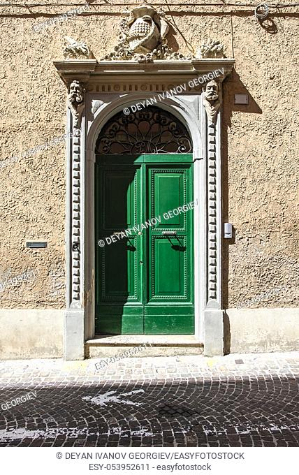 Typical italian facade with door. Italian house. Traditional style and ornaments