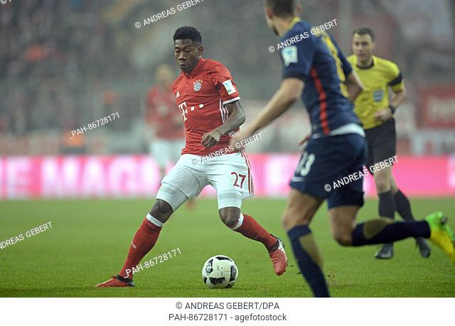 Munich's David Alaba (L) and Leipzig's Stefan Ilsanker vie for the ball during the German Bundesliga soccer match between Bayern Munich and RB Leipzig in the...