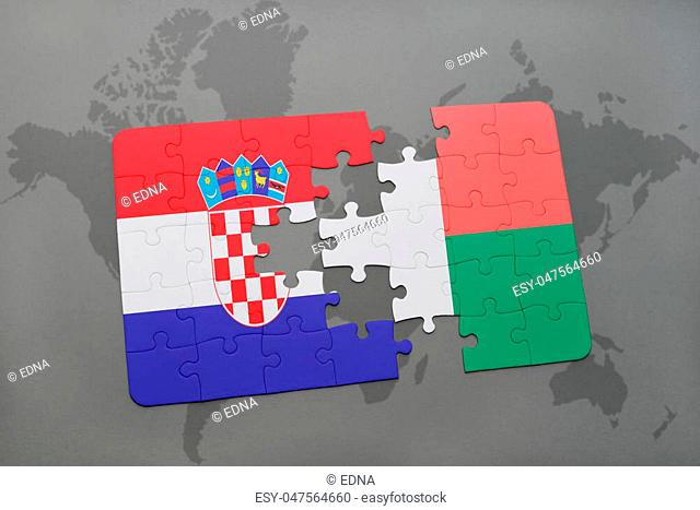 puzzle with the national flag of croatia and madagascar on a world map background. 3D illustration