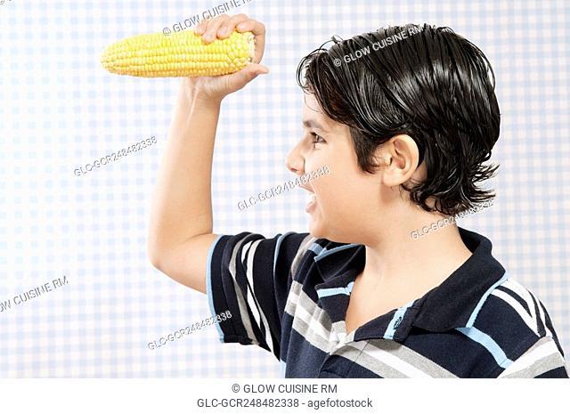Boy holding a corn cob