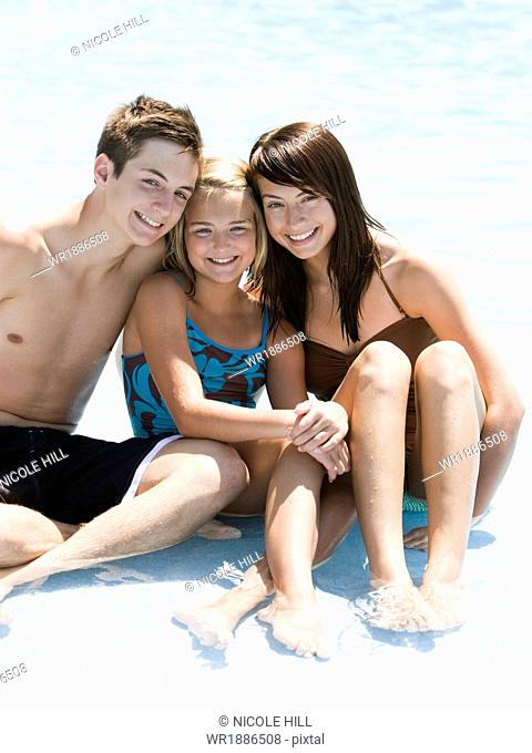 brother and sisters at a water park