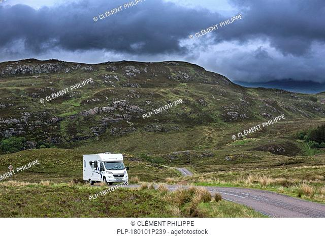 Motorhome / campervan driving along winding single track road with passing places in the Scottish Highlands, Ross-shire, Scotland, UK