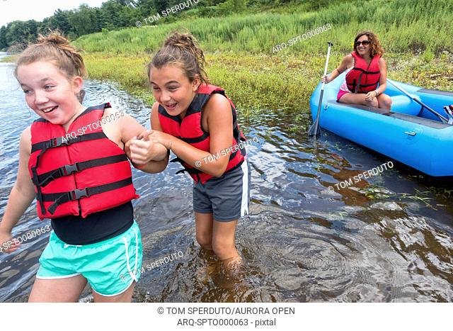 Two girls enjoy a rafting trip on the Delaware River in NJ