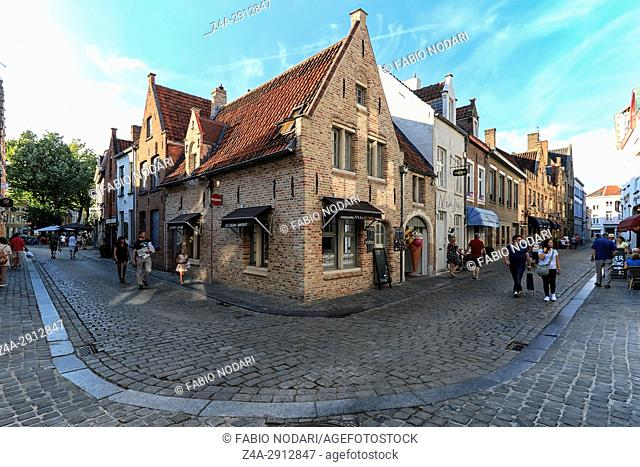 Bruges, Belgium - July 7, 2017: Tourists walking in a old street of Bruges, a medieval town of Belgium
