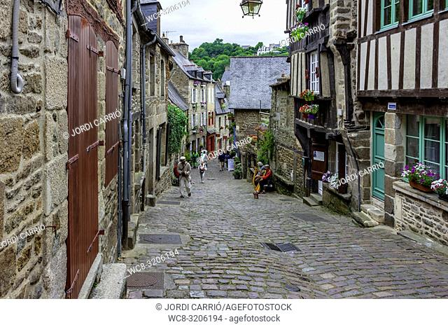DINAN, BRITAN, FRANCE - JUNE -2015: Rue du Petit Fort, one of the streets most frequented by tourists who visit the medieval city of Dinan on June 22, 2015