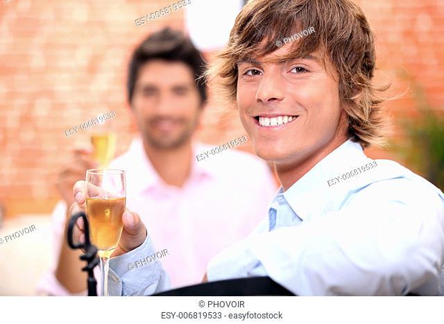 Men drinking champagne in a restaurant