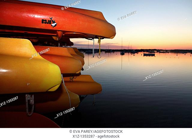 Colored canoes remain parked in the 'Estany of Peix' in Formentera, a mediterranean island of Spain