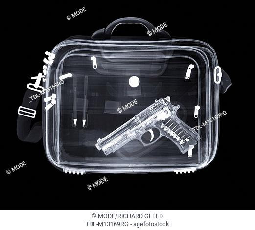 X-ray of a bag containing a gun and pens